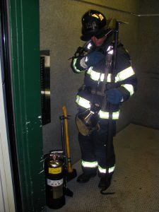 A properly equipped firefighter must be assigned to the position of elevator operator from the outset of elevator operations.  Photo courtesy Dave McGrail