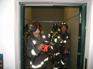 It's critical to inspect the hoistway for fire, smoke or water prior to traveling upward in an elevator car. This inspection procedure should be repeated when traveling longer distances, typically more than 10 flights.  Photo courtesy Dave McGrail