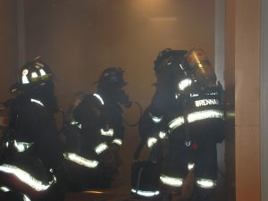 If there's smoke in the public hallway when we open the stairwell door, the door to the fire apartment is probably open. In this case, the company officer must make a decision as to whether to enter the hallway and close the door in an attempt to contain the fire.  Photo courtesy Keith Witt