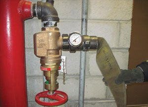 Always use a pressure gauge, especially when PRVs are present, so you know what you're getting off the standpipe under flow conditions.