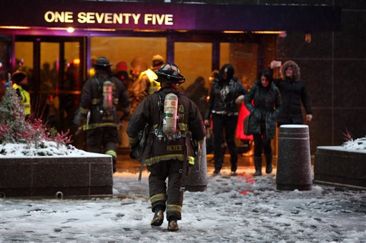Authorities respond to a fire at the John Hancock Center, Saturday, Nov. 21, 2015, in Chicago. Authorities say a fire that broke out about halfway up the building, one of Chicago's tallest skyscrapers, has been put out. (Brian Nguyen/Chicago Tribune via AP)