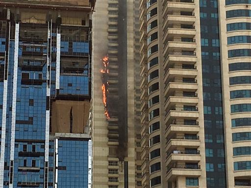 A fire rages at a skyscraper in the Dubai Marina section of Dubai, United Arab Emirates, Wednesday, July 20, 2016. It's the latest in a number of skyscraper fires across the United Arab Emirates in recent months. The most prominent was a New Year's inferno at a 63-story residence near the world's tallest tower. (AP Photo/Adam Schreck)
